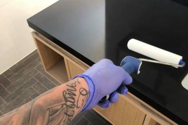 Applying sealer on polished concrete benchtop