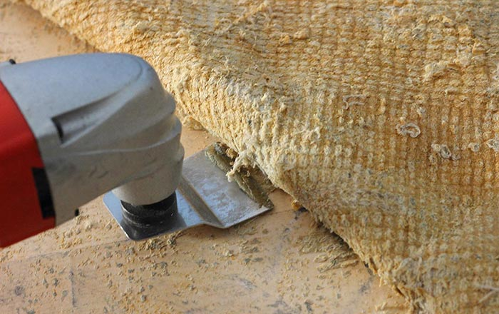 Surface prep by removing an old carpet with an electric tool