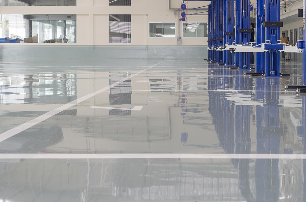 Epoxy flooring used in an auto repair shop