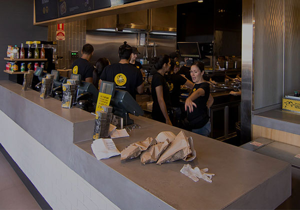 Custom-shaped cashier concrete benchtop for restaurant
