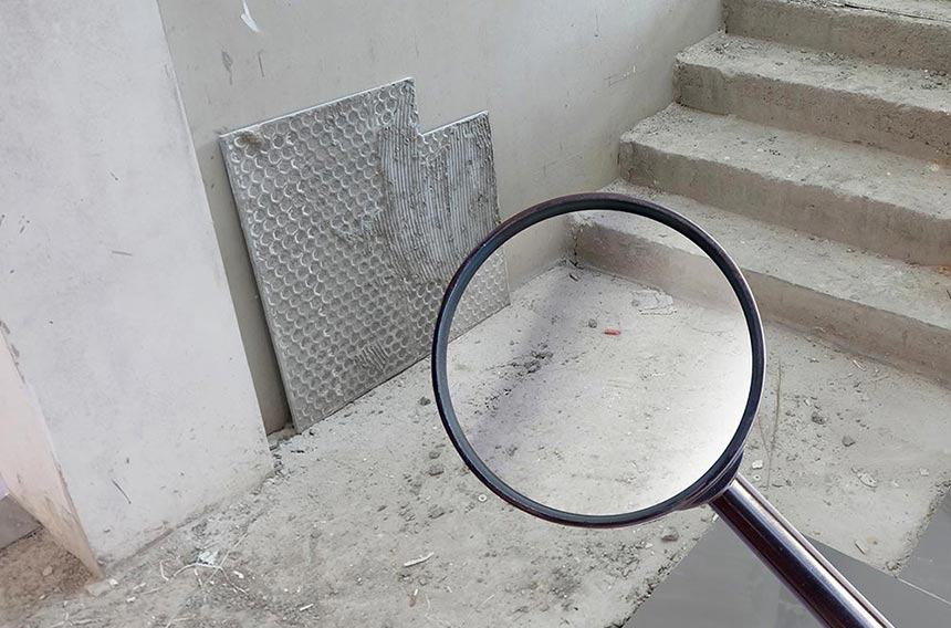 Magnifying glass over bare concrete floor and steps